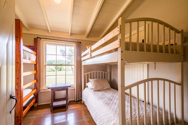 Bunk Room at Cottonwood Lodgege in Pipe Creek, Texas | Rancho Madrono