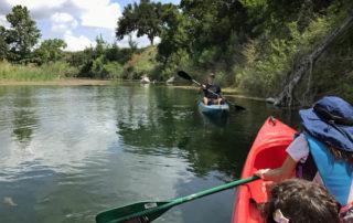 Kayaking Family enjoying Pipe Creek river recreation