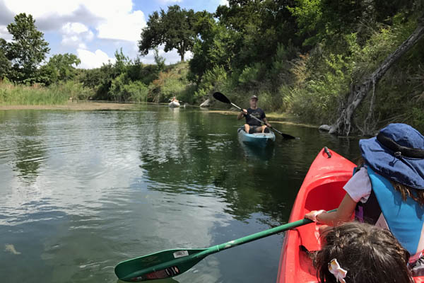 Kayaking Family enjoying Pipe Creek river recreation