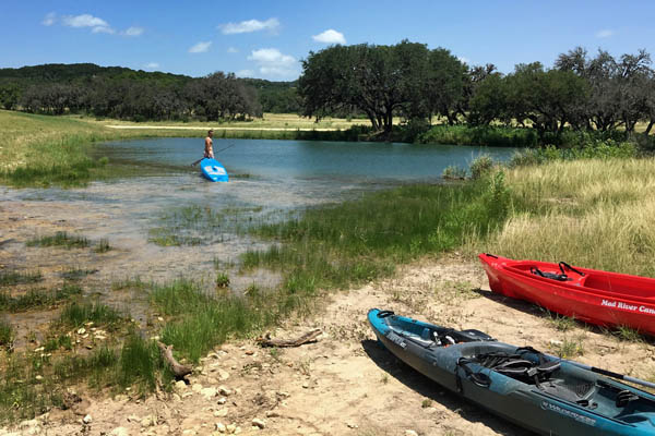 Kayaks on shore by Pipe Creek at Rancho Madrono