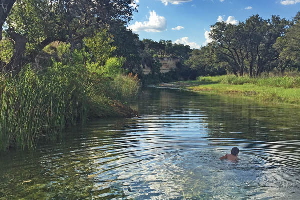 Swimming in Pipe Creek in Texas a live water creek