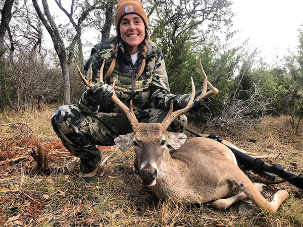 Woman with a nice whitetail buck